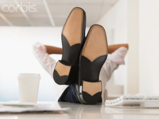 Businessman with Feet Up on Desk